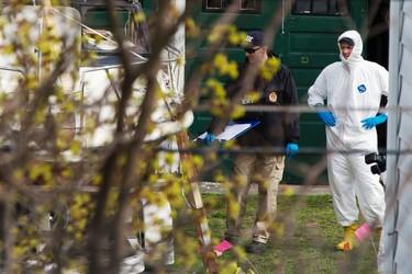 Members of the FBI Evidence Recovery Team inspect the boat where Boston Marathon bombing suspect Dzhokhar Tsarnaev was hiding at 67 Franklin St. in Watertown, Massachusetts, April 20, 2013.  REUTERS/Lucas Jackson