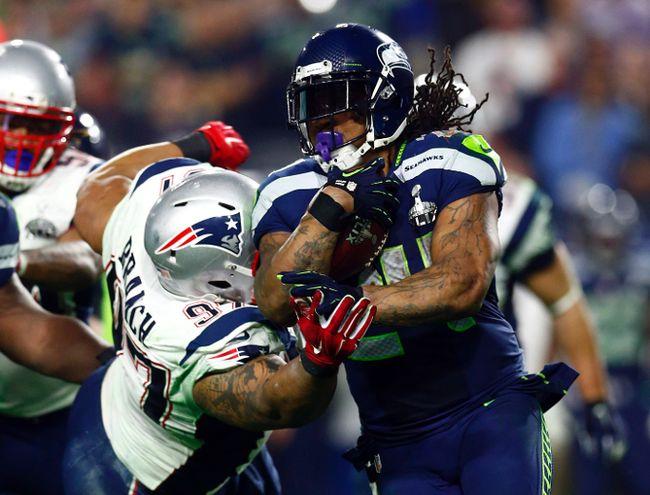 Seattle Seahawks running back Marshawn Lynch runs against New England Patriots nose tackle Alan Branch (97) during Super Bowl XLIX at University of Phoenix Stadium in Glendale, Ariz. (Mark J. Rebilas/USA TODAY Sports)