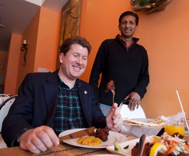 MP John Williamson meets with Naveen Polapady a Toronto restaurant owner.  File photo by MICHAEL PEAKE/ TORONTO SUN/ QMI AGENCY