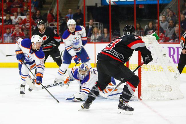 Mar 8, 2015; Raleigh, NC, USA; Carolina Hurricanes forward Jeff Skinner (53) scores a 2nd period goal past the Edmonton Oilers goalie Richard Bachman (32) and  defensemen Martin Marincin (85) at PNC Arena. Mandatory Credit: James Guillory-USA TODAY Sports