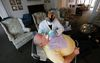 Mobile dental hygienist Hamid John works on patient John Wall. (Michael Peake/Toronto Sun)