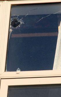 Super 8 bullet hole shooting 2015