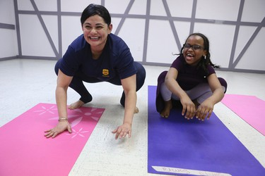 Constable Jeniffer Sidhu (L) with Yoga students on Wednesday, March 11, 2015. Veronica Henri/Toronto Sun/QMI Agency