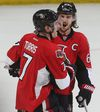 Ottawa Senators Kyle Turris and Erik Karlsson celebrate a goal against the Toronto Maple Leafs at the Canadian Tire Centre in Ottawa Saturday, March 21, 2015. (Tony Caldwell/Ottawa Sun/QMI Agency)