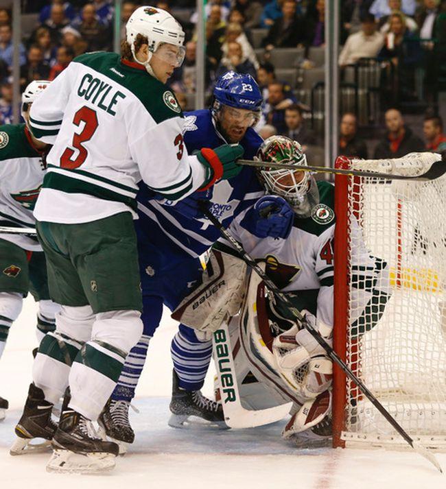 Toronto Maple Leafs� Trevor Smith (23) C�� crashes into Minnesota Wilds� Devan Dubnyk (40) G during the first period in Toronto on Monday March 23, 2015. Jack Boland/Toronto Sun/QMI Agency