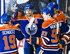 Oilers forward Jordan Eberle celebrates his first-period goal with his teammates. (Codie McLachlan, Edmonton Sun)