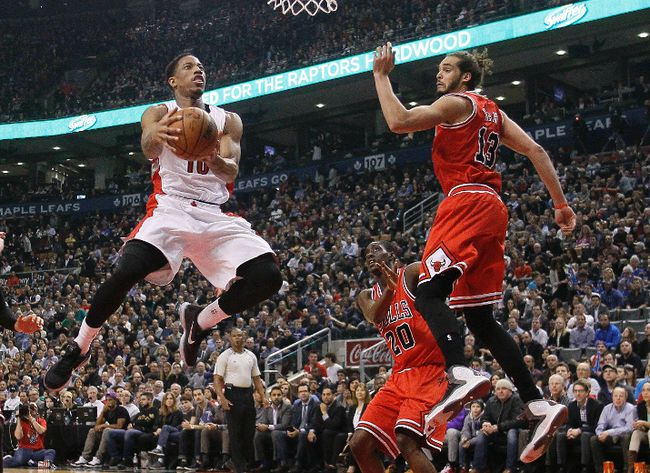 Mar 25, 2015; Toronto, Ontario, CAN; Toronto Raptors guard DeMar DeRozan (10) goes to make a basket as Chicago Bulls center Joakim Noah (13) looks on during the first half at the Air Canada Centre. John E. Sokolowski-USA TODAY Sports