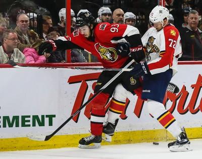 Ottawa Senators Mika Zibanejad battles with Florida Panthers Alex Petrovic during NHL hockey action at the Canadian Tire Centre in Ottawa, Ontario on March 29, 2015. Errol McGihon/Ottawa Sun/QMI Agency