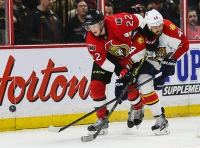 Ottawa Senators Erik Condra battles with Florida Panthers Erik Gudbranson during NHL hockey action at the Canadian Tire Centre in Ottawa, Ontario on March 29, 2015. Errol McGihon/Ottawa Sun/QMI Agency