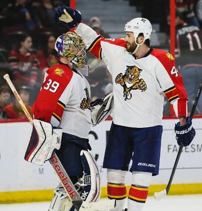 Florida Panthers Erik Gudbranson congratulates goaltender Dan Ellis after defeating the Ottawa Senators 4-2 during NHL hockey action at the Canadian Tire Centre in Ottawa, Ontario on March 29, 2015. Errol McGihon/Ottawa Sun/QMI Agency
