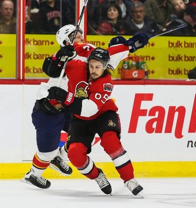 Ottawa Senators Erik Karlsson battles with Florida Panthers Dmitry Kulikov during NHL hockey action at the Canadian Tire Centre in Ottawa, Ontario on March 29, 2015. Errol McGihon/Ottawa Sun/QMI Agency