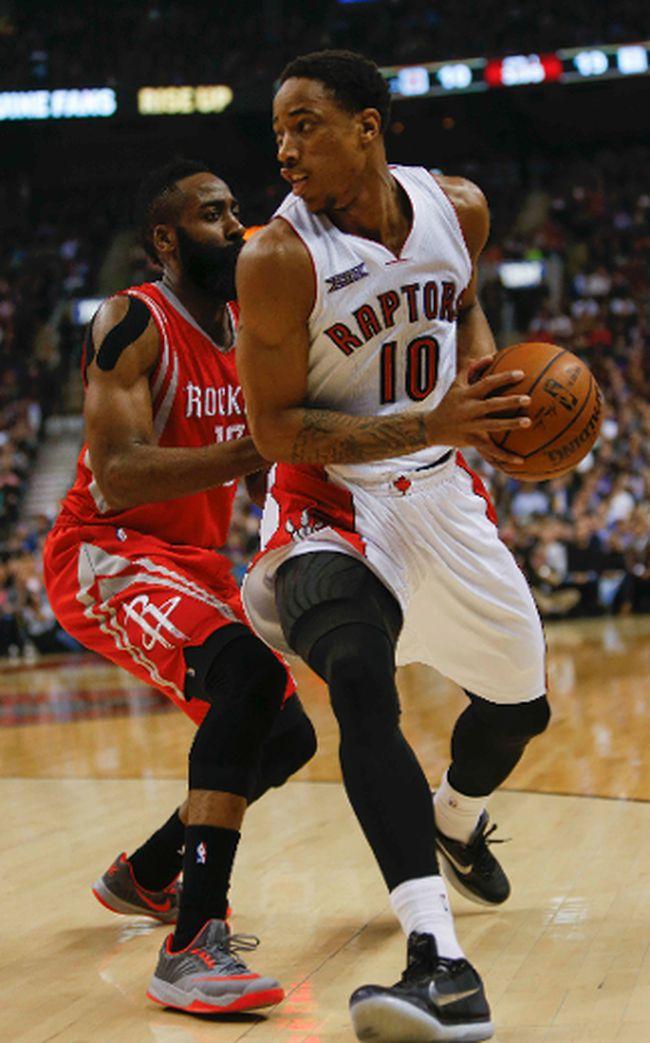 Toronto Raptors, DeMar DeRozan, vs Houston Rockets, James Harden, at the ACC. in Toronto, Ont. on Monday March 30, 2015. Dave Thomas/Toronto Sun