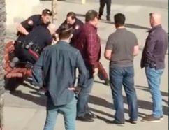 A screenshot of video that captured an arrest of a man who refused to pay a bar tab on 17 Ave. S.W.