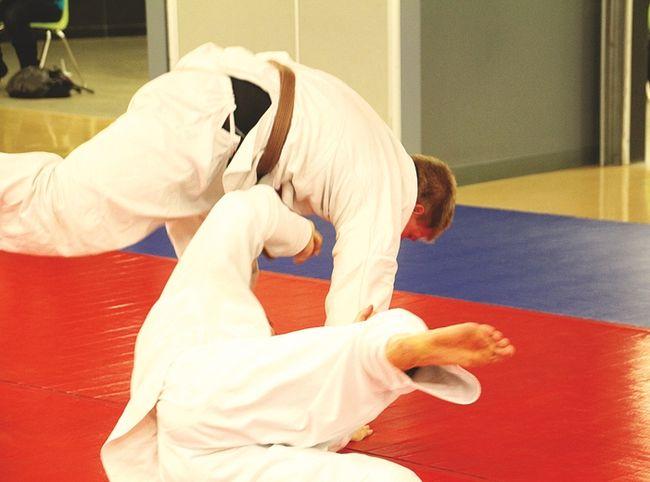 A simple judo takedown is demonstrated. (Matt Hermiz/TheGraphic/QMIAgency)