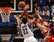 Raptors centre Jonas Valanciunas blocks Timberwolves' Andrew Wiggins from throwing down a dunk in Minneapolis last night.