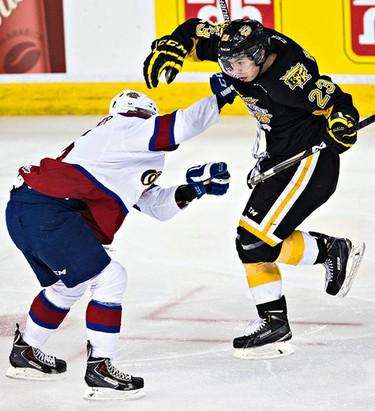 Edmonton's Ashton Sautner collides with Brandon's Tim McGauley during the second period of the Edmonton Oil Kings' WHL playoff hockey game against the Brandon Wheat Kings at Rexall Place in Edmonton, Alta., on Wednesday, April 1, 2015. Codie McLachlan/Edmonton Sun/QMI Agency