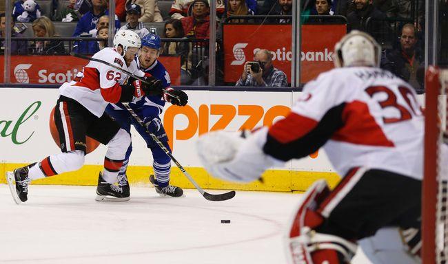 Ottawa Senators Eric Gryba (62) cuts off Toronto Maple Leafs James Van Riemsdyk (21) �during the first period in Toronto on Sunday April 6, 2015. Jack Boland/Toronto Sun/QMI Agency