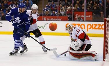 Ottawa Senators Andrew Hammond (30) makes a save on Toronto Maple Leafs Richard Panik during the first period in Toronto on Sunday April 6, 2015. Jack Boland/Toronto Sun/QMI Agency