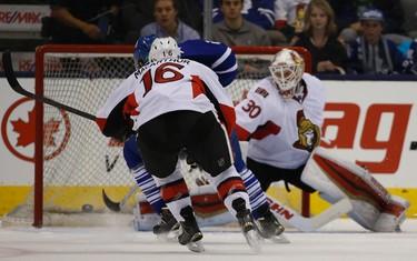 Toronto Maple Leafs� James Van Riemsdyk (21)  beats Ottawa Senators Andrew Hammond (30) during the second period in Toronto on Sunday April 5, 2015. Jack Boland/Toronto Sun/QMI Agency