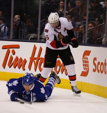 Ottawa Senators Bobby Ryan (6) checks Toronto Maple Leafs Dion Phaneuf (3) D to the ice during the second period in Toronto on Monday April 6, 2015. Jack Boland/Toronto Sun/QMI Agency