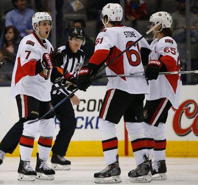 Ottawa Senators Kyle Turris (7) comes to congratulate Mark Stone (6) on his game tying goal in the third period in Toronto on Sunday April 5, 2015. Jack Boland/Toronto Sun/QMI Agency