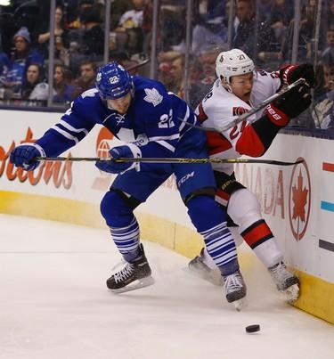 Toronto Maple Leafs Zach Sill (22) checks Ottawa Senators Curtis Lazar (27)off the puck in third period  in Toronto on Monday April 6, 2015. Jack Boland/Toronto Sun/QMI Agency
