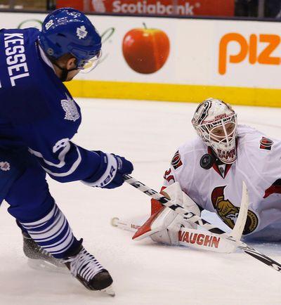 Ottawa Senators Andrew Hammond (30) robs Toronto Maple Leafs Phil Kessel (81) in the third period in Toronto on Sunday April 5, 2015. Jack Boland/Toronto Sun/QMI Agency