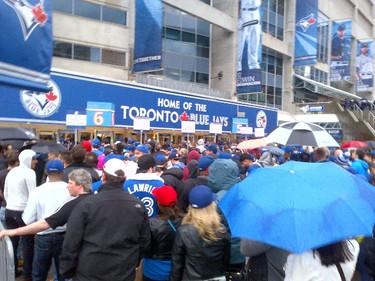 Security lineups before the season opener at the Rogers Centre in Toronto, Ont. on Monday April 13, 2015. Joe Warmington/Toronto Sun/Postmedia Network