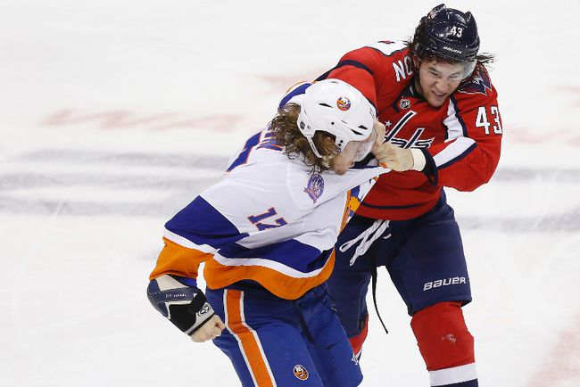 Washington Capitals winger Tom Wilson (43) fights New York Islanders left wing Matt Martin (17) during NHL play at the Verizon Center. (Geoff Burke/USA TODAY Sports)