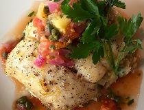 Chef Paul Coriander crusted halibut with tomato caper relish. (Supplied)
