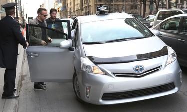 Ottawa Senators Milan Michalek  and Zack Smith get into a taxi in downtown Montreal Thursday April 16,  2015. Tony Caldwell/Postmedia Network