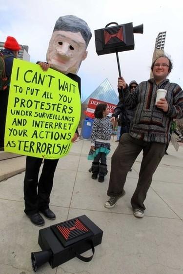 Stuart Andrews (r) carry a fake camera during a C51 protest at Churchill Square in Edmonton, Alberta on Saturday April 18, 2015. Perry Mah/Edmonton Sun/Postmedia Network