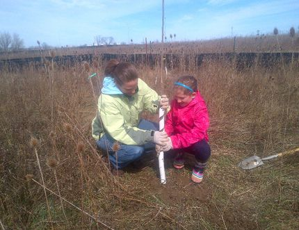 Heidi and Alicia Melick planting trees