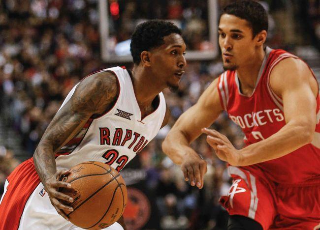Toronto Raptors, Lou Williams gets past Houston Rockets, Nick Johnson, at the ACC. in Toronto, Ont. on Monday March 30, 2015. Dave Thomas/Toronto Sun