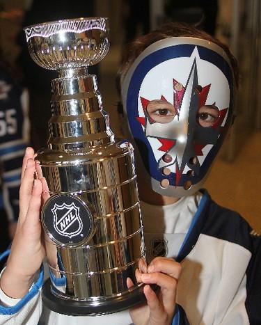 Winnipeg Jets fan Keaton Hamin hoists a Stanley Cup in Winnipeg, Man. Monday April 20, 2015 prior to game three of the NHL playoffs between the Winnipeg Jets and the Anaheim Ducks. Brian Donogh/Winnipeg Sun/Postmedia Network