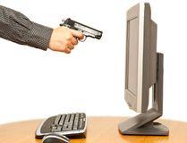 Man shooting computer. (Fotolia)