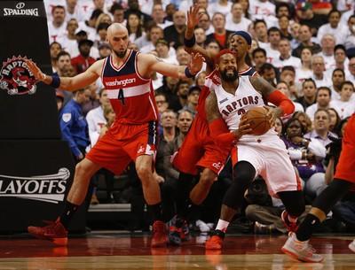 Washington Wizards' Marcin Gortat (4) guards against Toronto Raptors' James Johnson (3) in the first half on April 21. (Jack Boland/Toronto Sun/Postmedia Network)