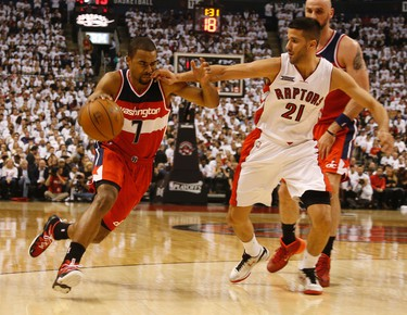 Toronto Raptors' Greivis Vasquez (21) fouls Washington Wizards' Ramon Sessions on April 21. (Jack Boland/Toronto Sun/Postmedia Network)