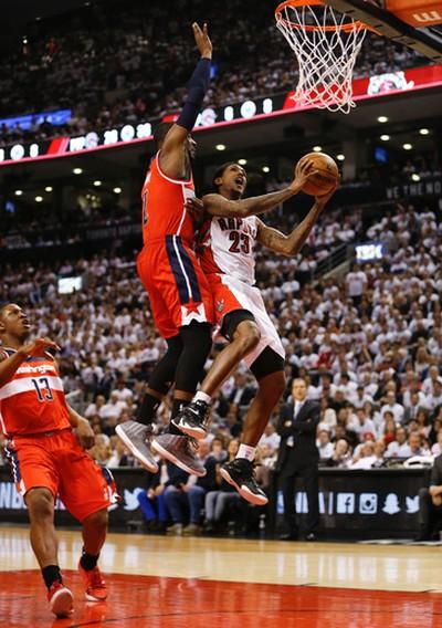 Washington Wizards' John Wall (2) goes up to the net hard against Toronto Raptors' Lou Williams (23) on April 21. (Jack Boland/Toronto Sun/Postmedia Network)