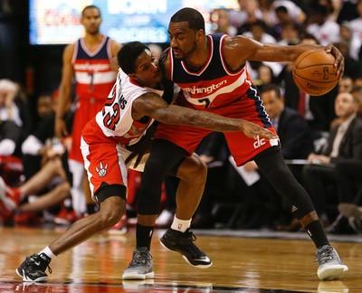 Toronto Raptors' Lou Williams (23) reaches in on Washington Wizards' John Wall on April 21. (Jack Boland/Toronto Sun/Postmedia Network)