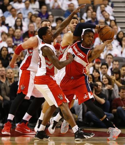 Toronto Raptors' Lou Williams (23) reaches in on Washington Wizards' Bradley Beal on April 21. (Jack Boland/Toronto Sun/Postmedia Network)