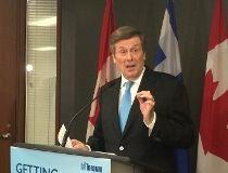 Mayor John Tory speaks to reporters on Friday, April 24, 2015. (DON PEAT/Toronto Sun)