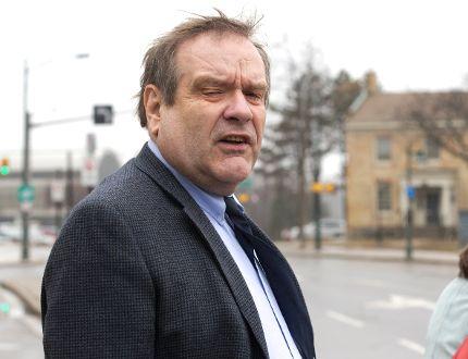 Wayne Morrison leaves London courthouse. (DEREK RUTTAN, The London Free Press)