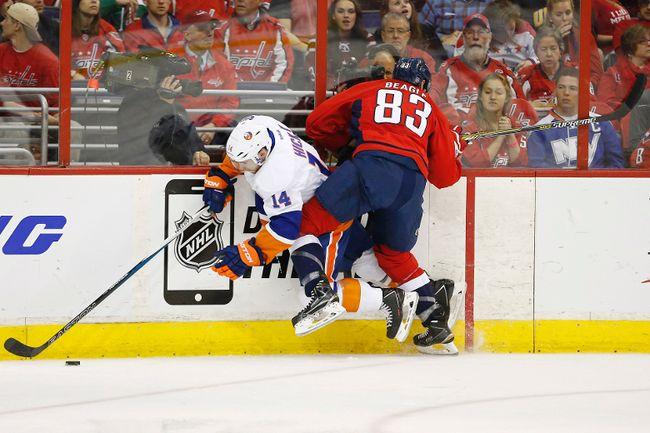 Washington Capitals centre Jay Beagle checks New York Islanders defenceman Thomas Hickey during Game 5 on Thursday night. (USA TODAY SPORTS)