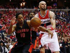 Toronto Raptors guard DeMar DeRozan (10) knocks the ball from Washington Wizards centre Marcin Gortat (4) in the second quarter of Game 3. (Geoff Burke-USA TODAY Sports)