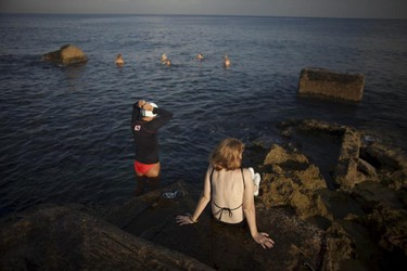 People enjoy the sea early in the morning in Havana, April 28, 2015. REUTERS/Alexandre Meneghini