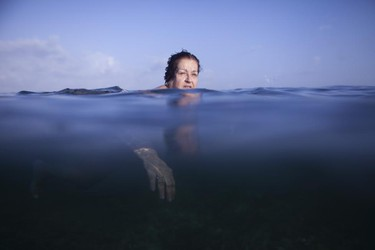 Retired chef Edita Mijares, 67, swims in the sea in Havana, April 28, 2015.  REUTERS/Alexandre Meneghini