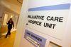 A woman walks past a palliative care hospice unit at an Edmonton hospital.  Ian Kucerak/Edmonton Sun/Postmedia Network