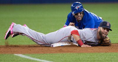 Toronto Blue Jays Devon Travis slides hard into second base  against the Boston Red Sox Dustin Pedroia  in Toronto, Ont. on Sunday May 10, 2015. Craig Robertson/Toronto Sun/Postmedia Network