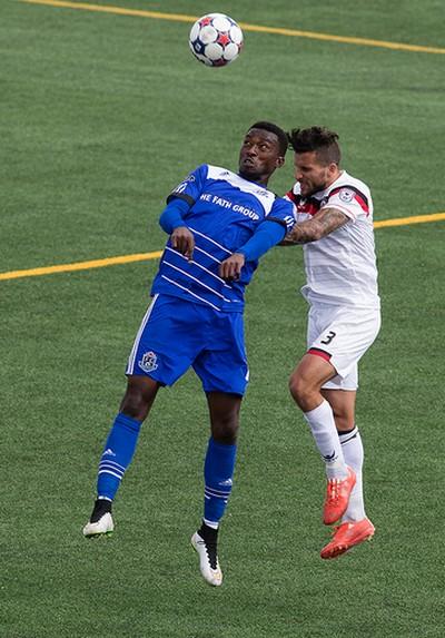 FC Edmonton's Tomi Ameobi (18) battles the Atlanta Silverbacks' Paul Black (3) during NASL action at Clarke Field, in Edmonton Alta. on Sunday May 24, 2015. David Bloom/Edmonton Sun/Postmedia Network